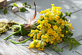 Spring bouquet made of primula veris (cowslip, heavenly key)