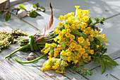 Spring bouquet made of primula veris (cowslip, heavenly key)