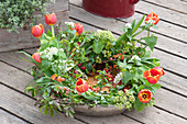 Spring wreath in bowl with water