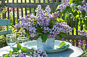 Syringa vulgaris (lilac) bouquet on tray