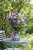 Rural bouquet of Aquilegia and Rubus rods