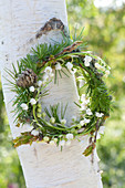 Small wreath of Convallaria majalis (lily of the valley) with twigs