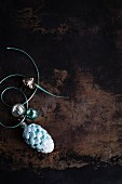 Turquoise pine cone Christmas tree bauble
