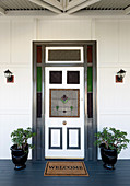 Classic front door with stained glass with symmetrical decoration