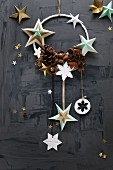 Christmas arrangement of stars and pine cones on ring