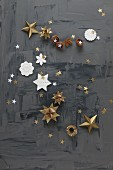 Paper and modelling clay stars on black surface