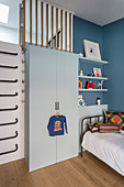 Wall bars next to wardrobe in boy's bedroom