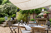 Garden table and chairs under awning