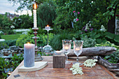 Table set with candles and tealights in garden
