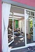 View from terrace into living room through open terrace door