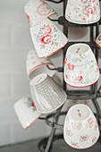 Vintage-style floral mugs on bottle rack