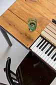 Piano keyboard integrated below dining table