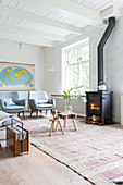 Log burner in bright, Scandinavian-style living room