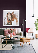 Feminine living room with horse picture on purple wall