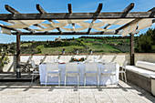 Set table below pergola on terrace