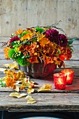 Autumnal arrangement of dahlias, freesias, marigolds and asclepias