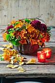 Autumnal arrangement of dahlias, freesias, marigolds and asclepias