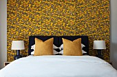 Bedroom with black, white and yellow colour scheme and wallpaper with graphic pattern