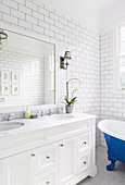 Double sink in the vanity with marble top in the white bathroom