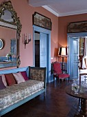 Pink wall and blue panelled doors in historical lounge