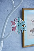 Snowflake made from stitched paper shapes
