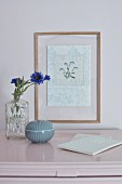 Framed embroidered floral motif and vase of cornflowers