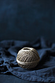 Ball of string on blue fabric