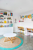 Colorful color accents in the white playroom