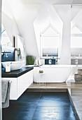 A free-standing bath tub in an elegant attic bathroom