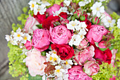 Lavish bouquet of roses, fruit blossom and lady's mantle