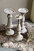Rustic candlesticks on fur