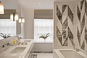 Geometric wall tiles above bathtub in white modern bathroom