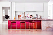 Elegant kitchen counter with marble countertop and red front