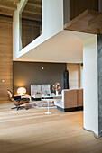 Classic designer furnishings in living area below mezzanine