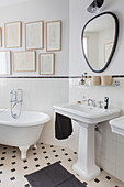 Half-height tiled wall in vintage-style bathroom