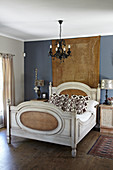 French sleigh bed in bedroom with slate-grey wall