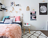 White metal bed in the girls room