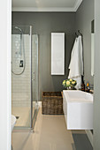 Designer sink and shower cabinet in bathroom