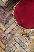 Herringbone-patterned brick paving