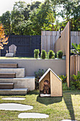 Dog house in the modern garden with two levels