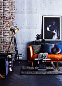 Masculine living room in a blue industrial style with leather sofa