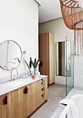 Long wooden washstand in modern bathroom