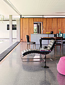 Terrazzo floor in open-plan interior of architect-designed house