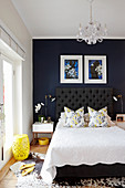 Dark blue wall in elegant bedroom