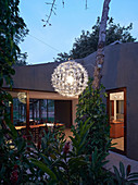 Designer lamp in garden of house with panoramic windows