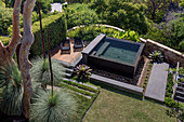 View of garden with pool and grass trees (Xanthorrhoea)