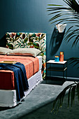 Individual, upholstered headboard, cover with plant motif, on double bed