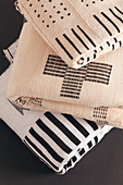 Folded blankets with graphic black and white patterns