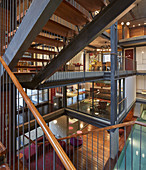 View from staircase into open-plan storeys of architect-designed house