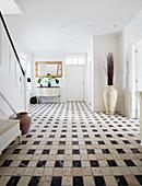 Black-and-white, patterned tiled floor in foyer